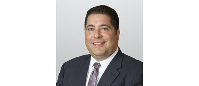 Adam J. August