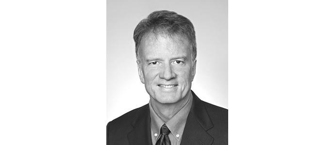 C. Mark Kittredge