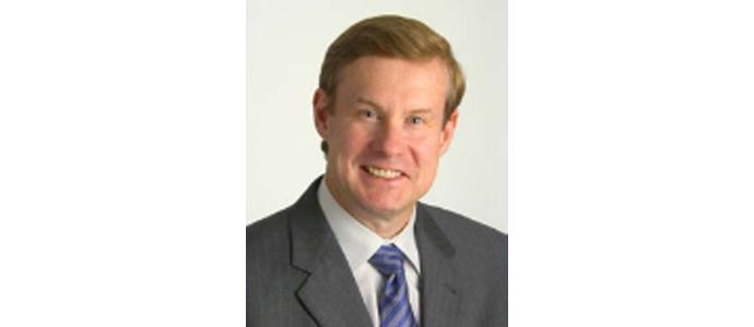 Charles E. Harrell PC