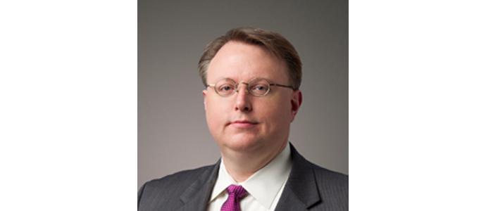 Derek A. Roach