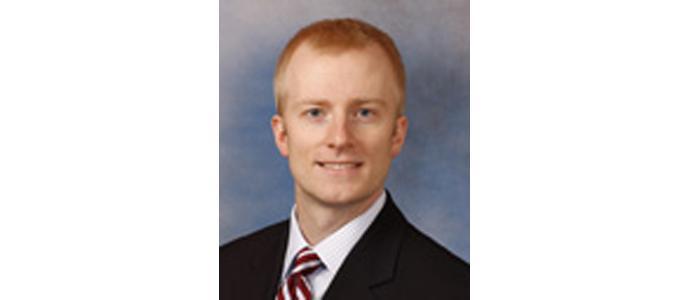 Joshua E. Holt